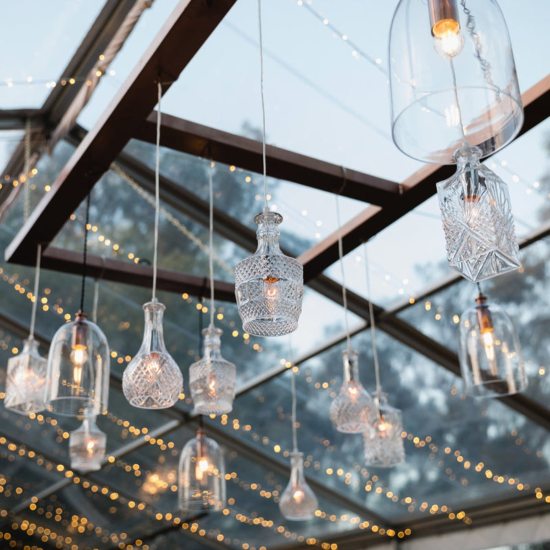 wine decanter glass pendant lights hanging in a reception venue