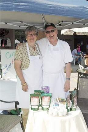 Corin Mullins and Brian Mullins selling Holy Crap cereal at the Sechelt Farmers Market