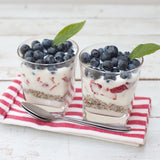 Layer Skinny B cereal with yogurt and fruit for a breakfast parfait