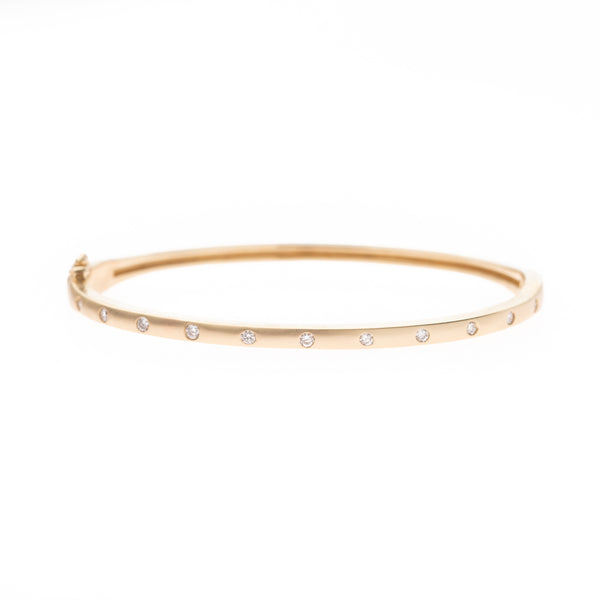Eleven Diamonds Set in Gold Band Bracelet