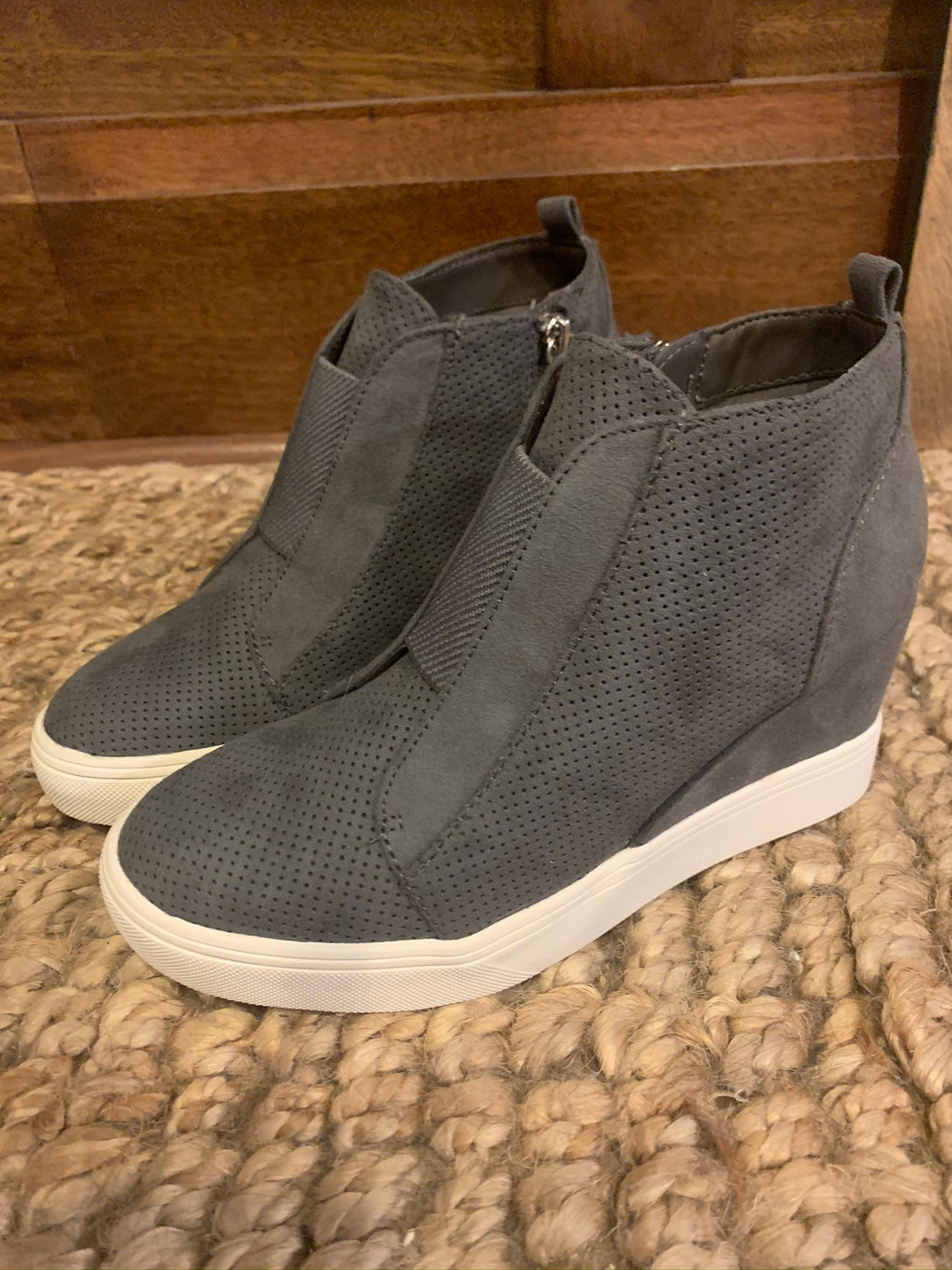 Grey wedge sneakers with zipper detail on the side