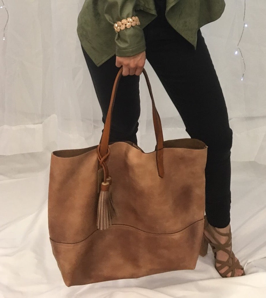 Large beige tote with tassel detail