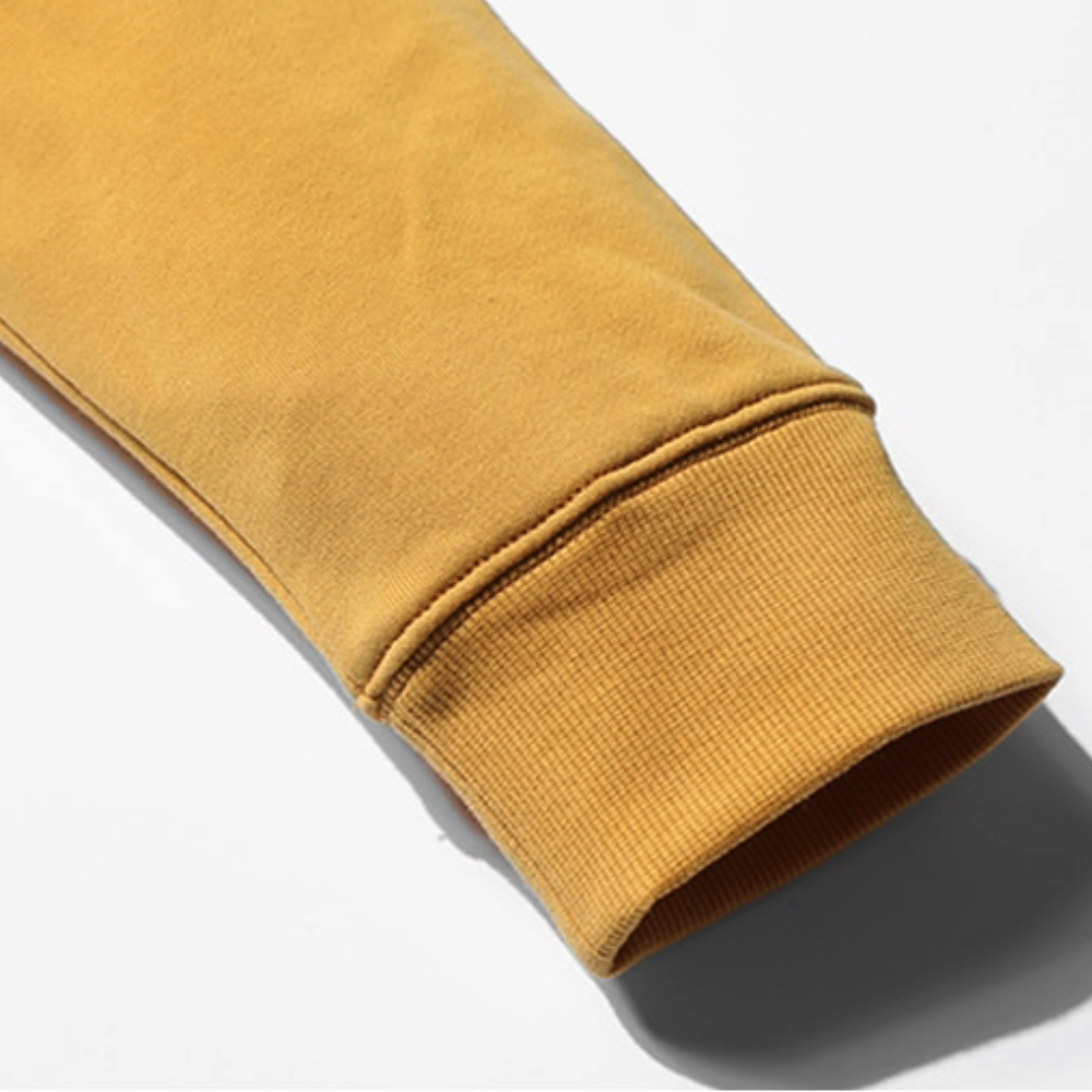 Close Up Sleeve View of Yellow SIMWOOD Embroidered Pullover Hoodie