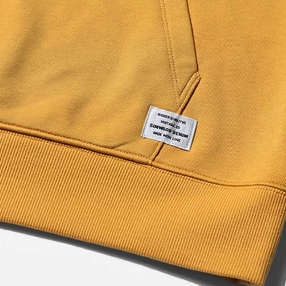Close Up Pocket and Waistline View of Yellow SIMWOOD Embroidered Pullover Hoodie