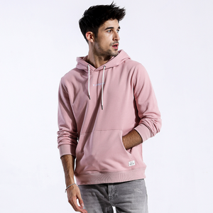 Model Featuring Front View of Light Pink SIMWOOD Embroidered Pullover Hoodie