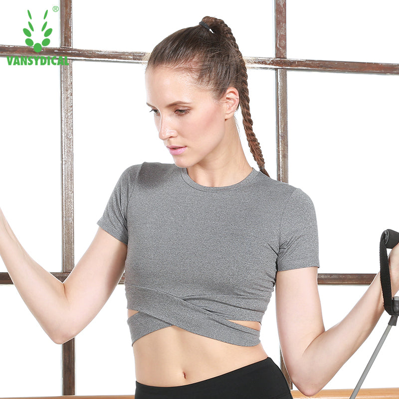 Female Model Featuring Front View of the Grey Vansydical Short Sleeve Yoga Crop Top