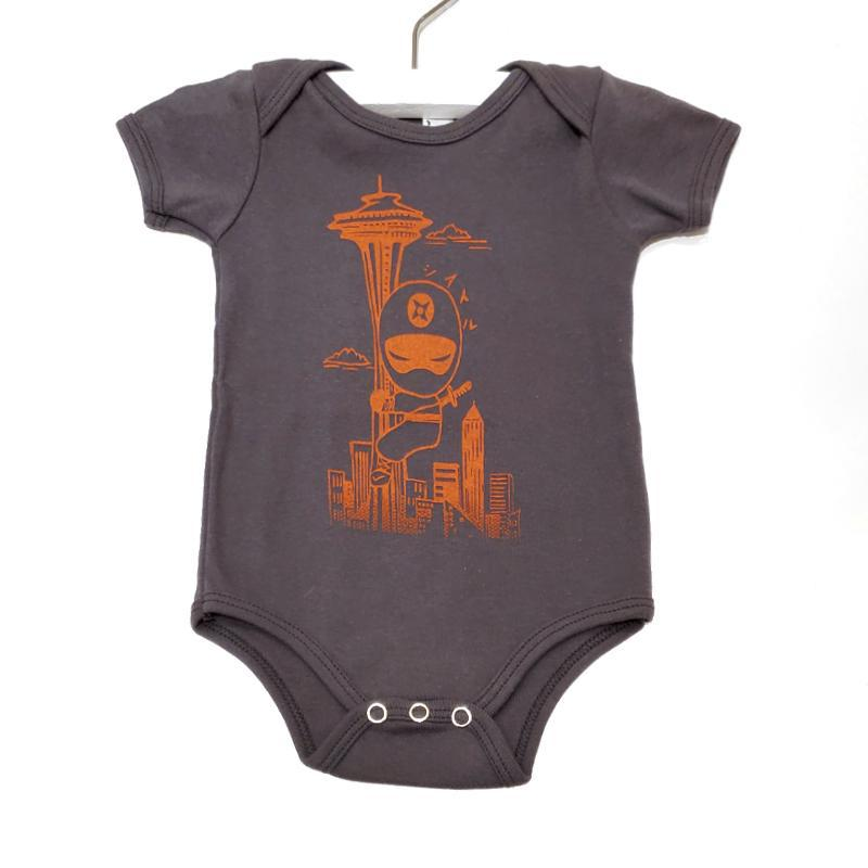 Onesie - Orange Ninja Space Needle On Dark Gray by Namu