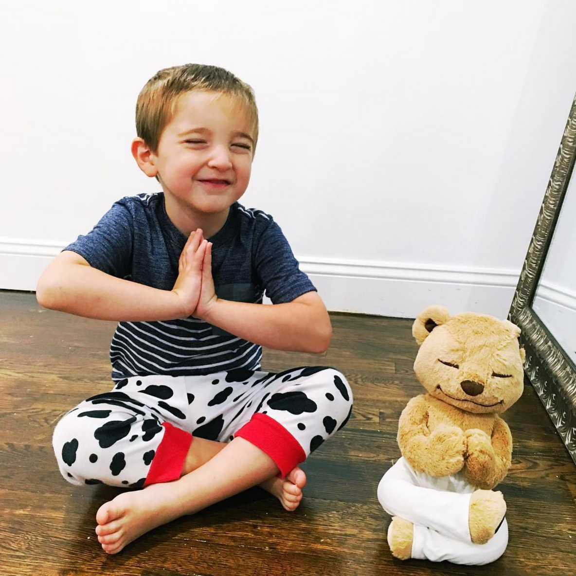 A Kid Practicing Yoga with Meddy Teddy