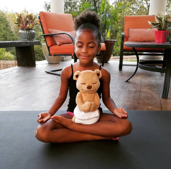 A Child Meditating with Meddy Teddy