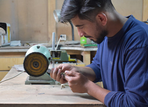 Afghan jewelers working on the Pamela Love Kyleigh Moon Phase Necklace
