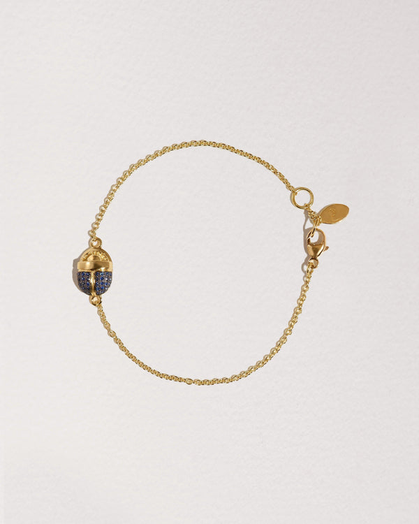 scarab gold chain bracelet with sapphire