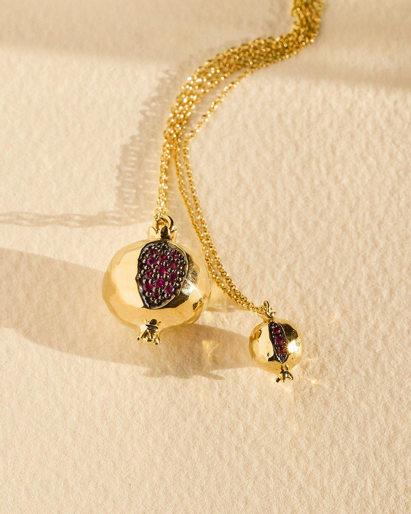 gold pomegranate pendant with ruby seeds
