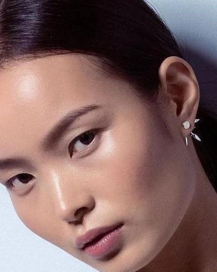beam earrings on the model