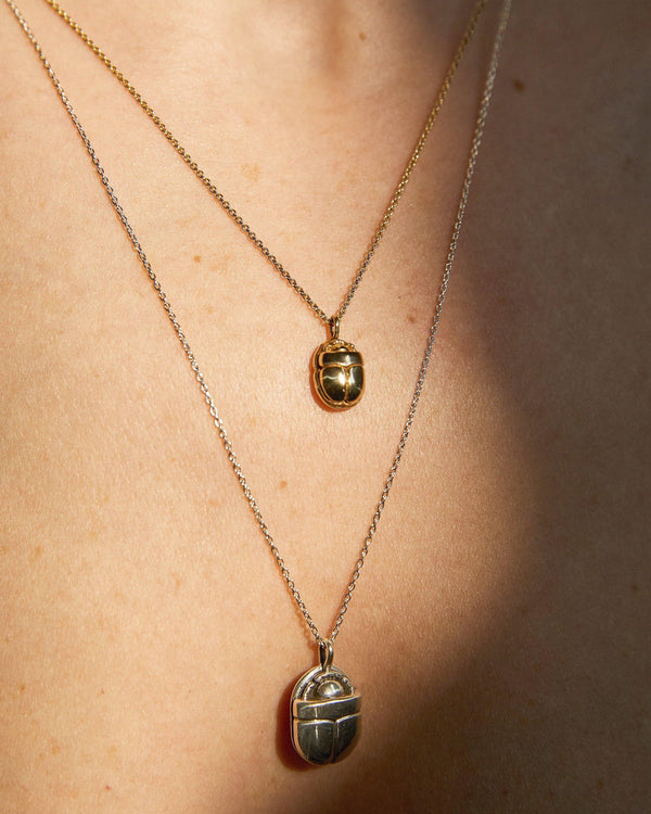 scarab necklaces on the model