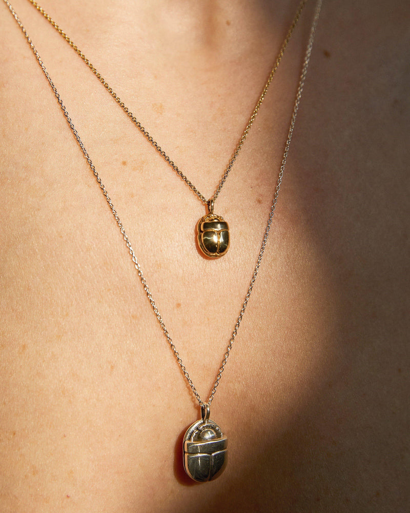 scarab pendants on model
