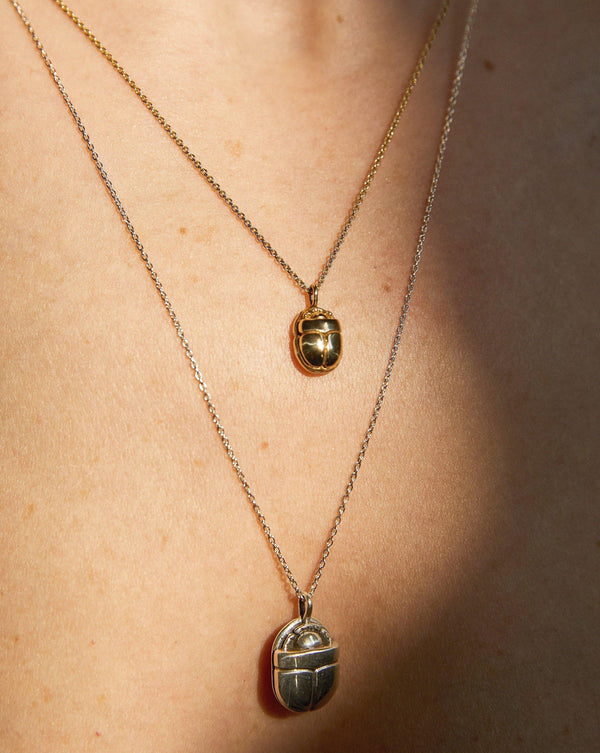 scarab pendants on the model