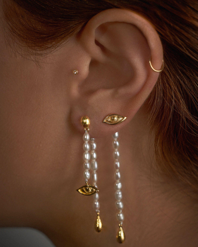 crying eye ear jacket drop earrings on the model