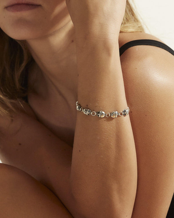 scarab link bracelet on the model