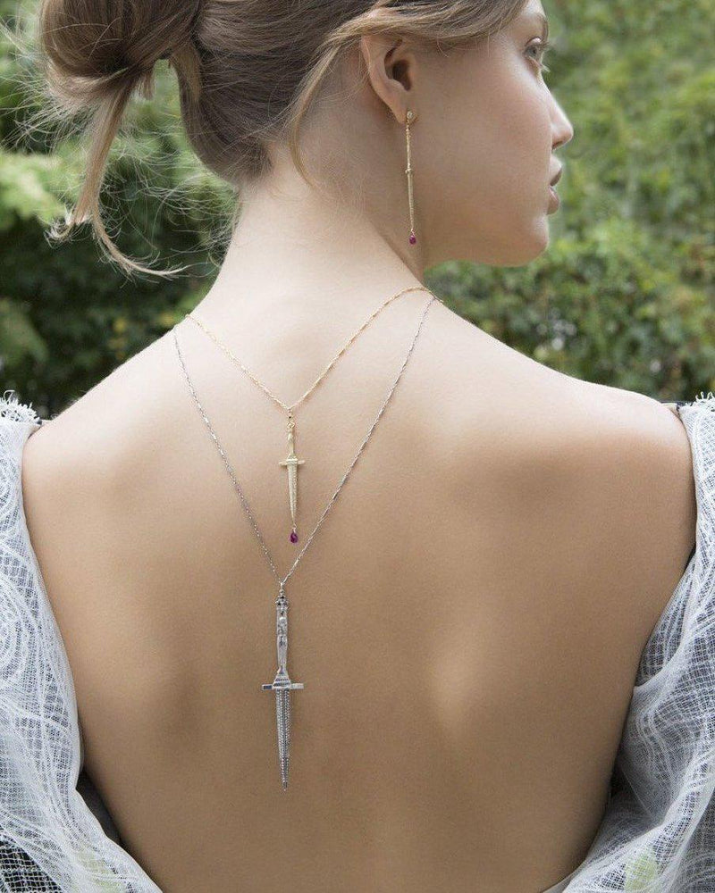 dagger necklaces on the model