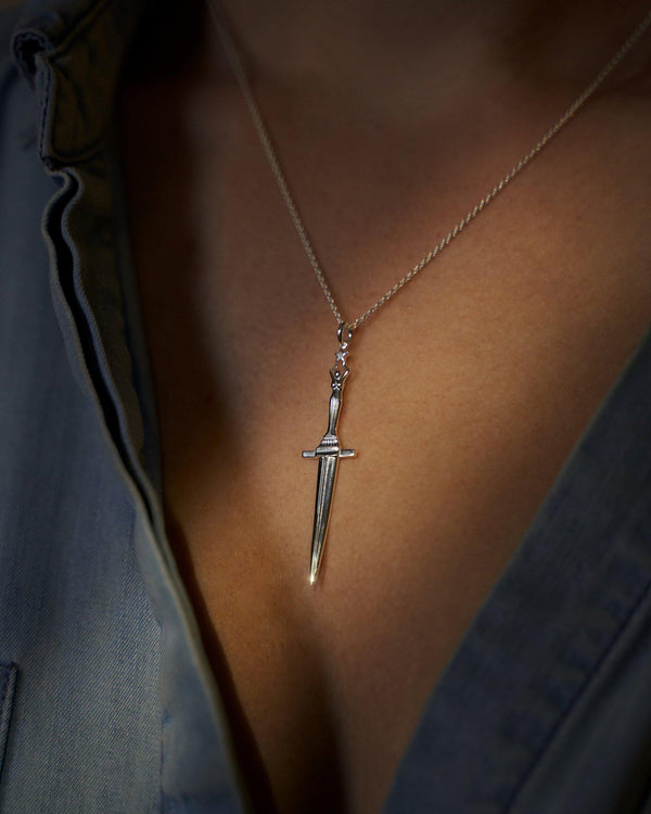 dagger necklace on model