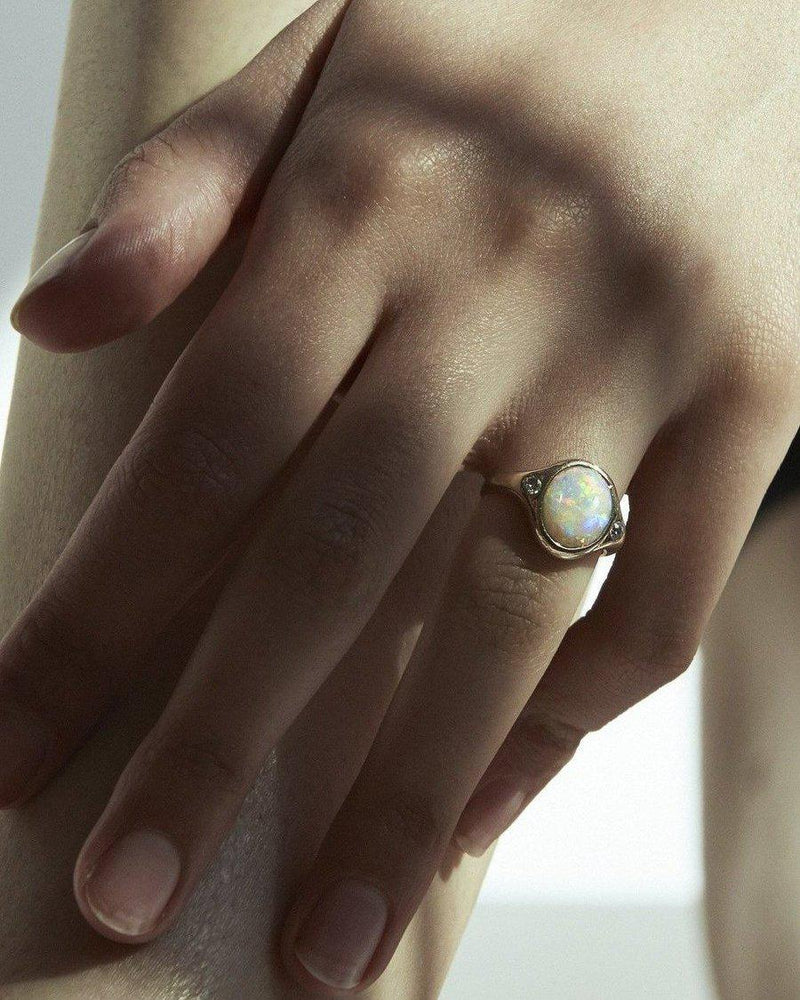 silver essential ring on the models hand
