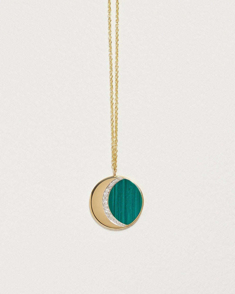malachite inlay moon phase pendant with 18k yellow gold and white diamonds