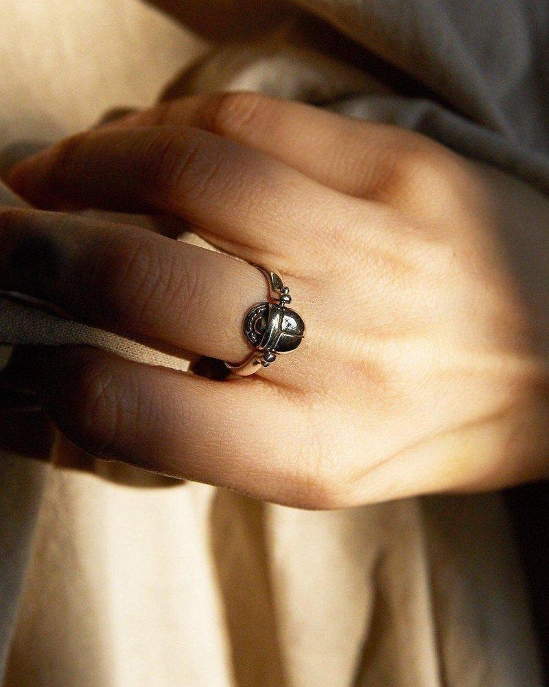 scarab ring on the models hand
