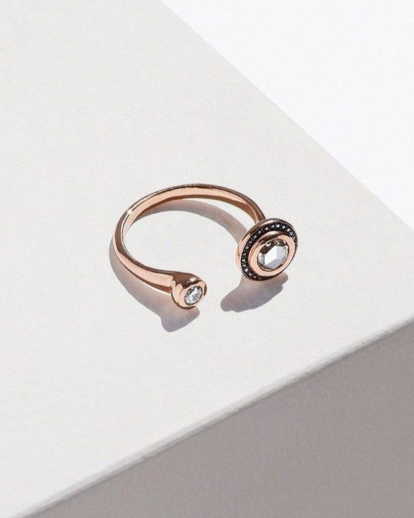 gravitation ring with rose gold and diamonds