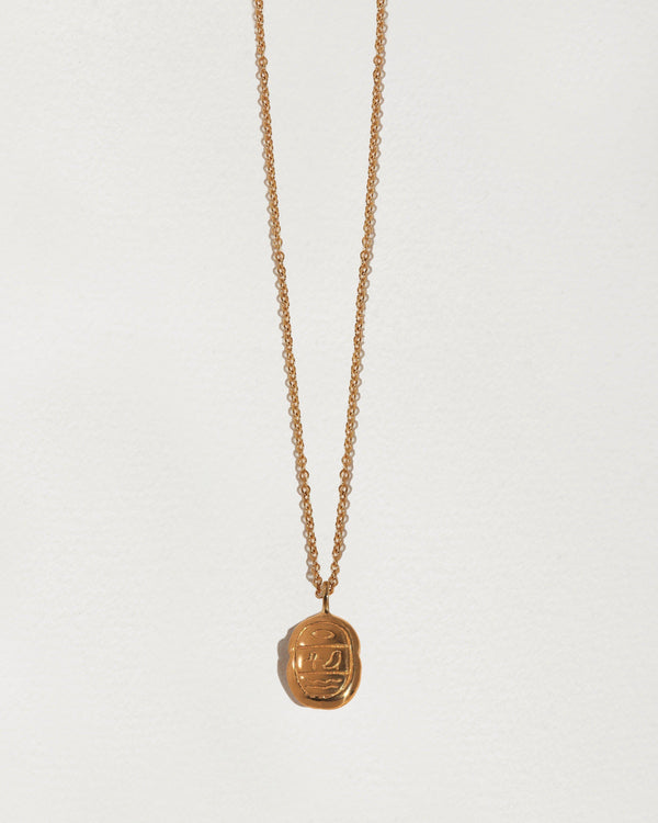 mini gold scarab pendant