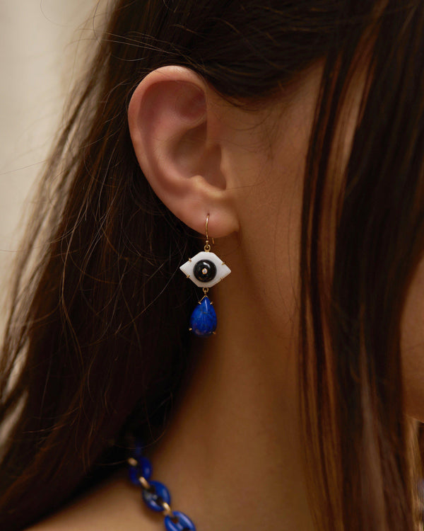 lapis drop eye earrings on the model