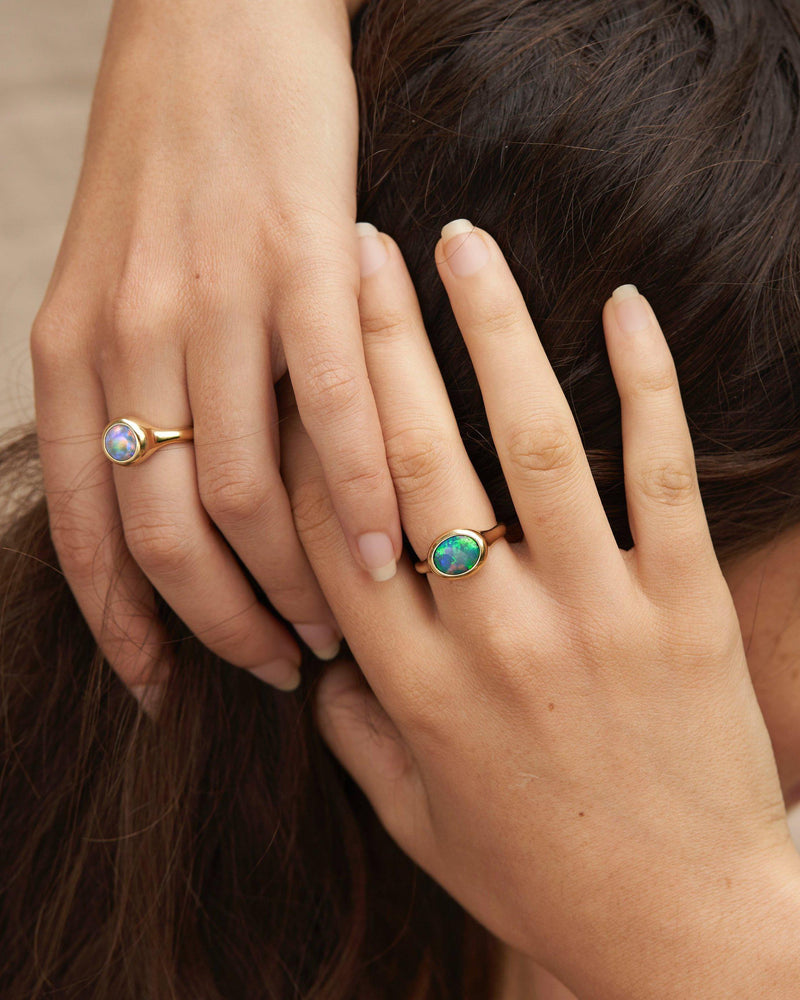 gold opal ring on models hand
