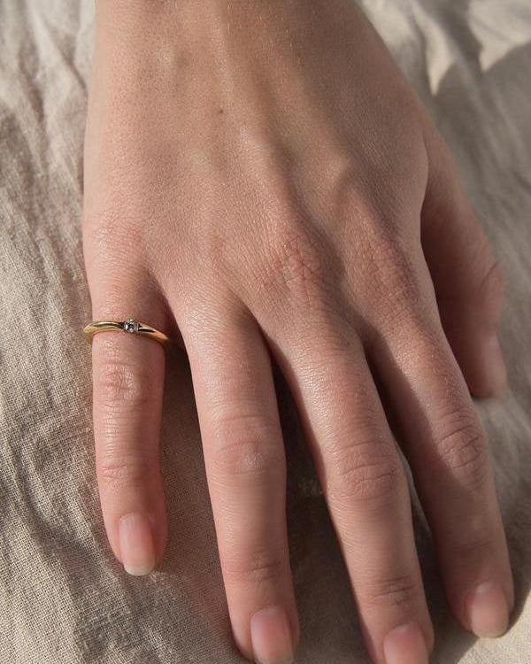 floating diamond ring on models hand