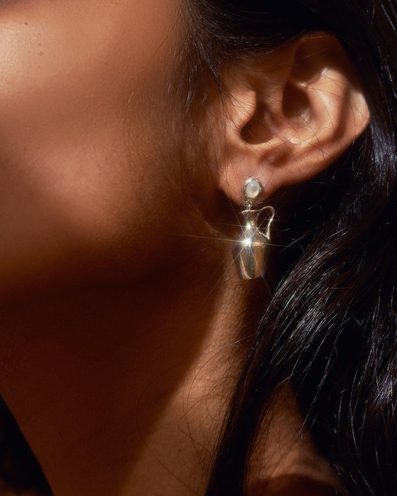 vessel earrings on the model