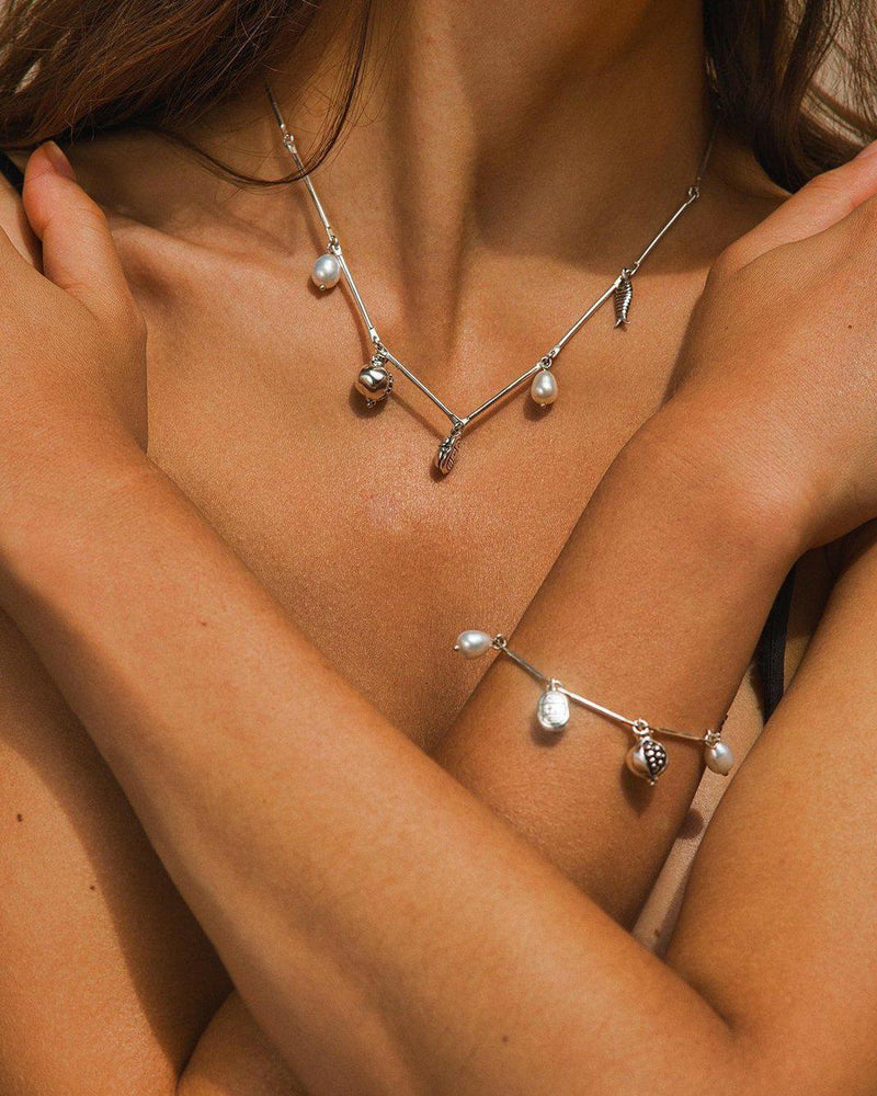 silver necklace with pearls on the model