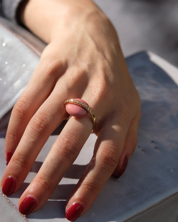 pink opal comet ring with diamonds on models hand