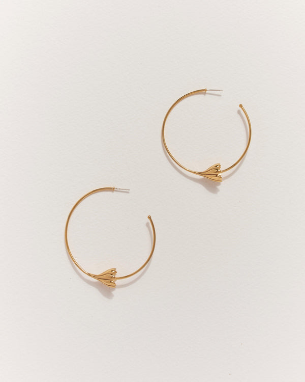 brass hoop earrings with anemone flower
