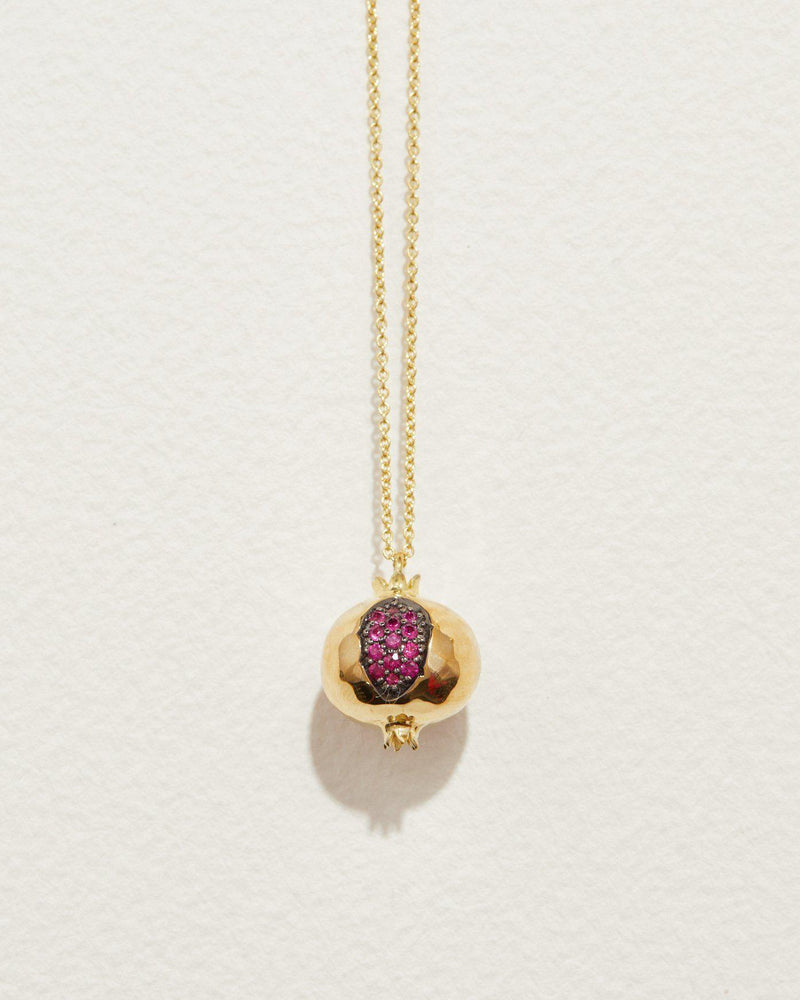 pomegranate pendant with ruby and 18k yellow gold