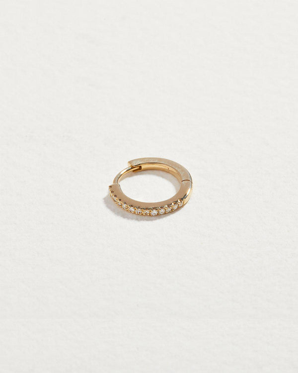 diamond huggie earring with 14k yellow gold