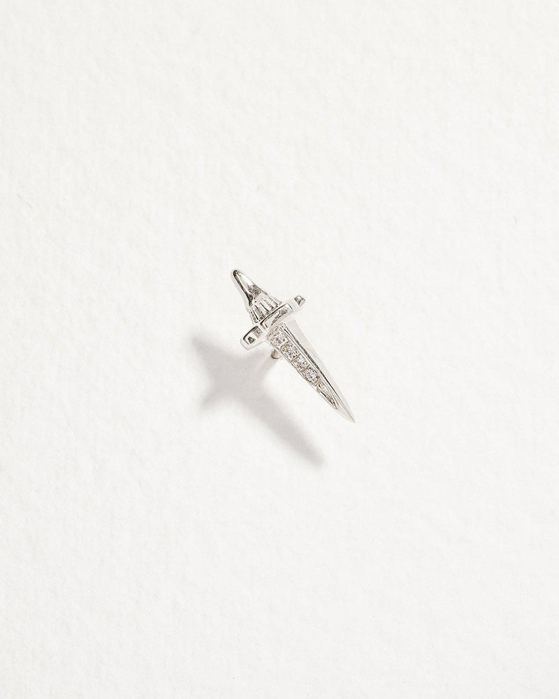 dagger stud piercing with diamonds and white gold