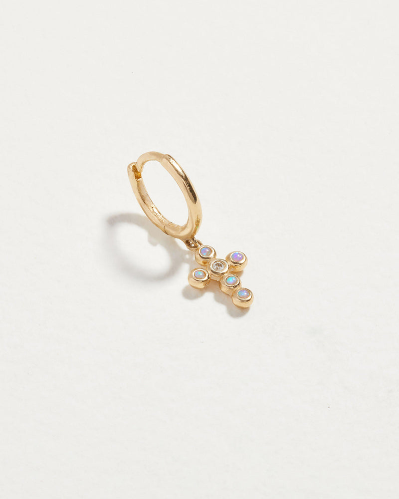 cross cluster huggie piercing with opal and diamonds