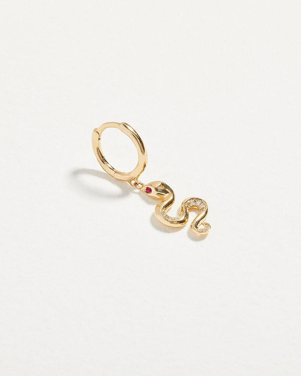 snake huggie earring with ruby eyes and diamonds