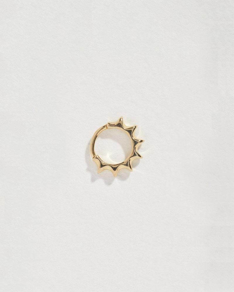 14k yellow gold sun huggie piercing