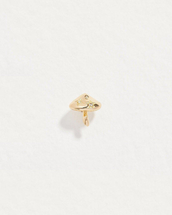 gold mushroom stud piercing with diamond