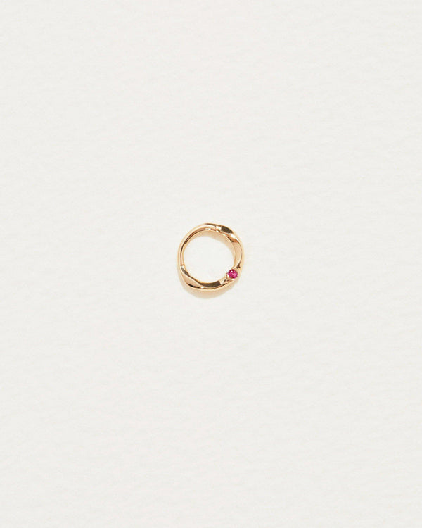 6mm floating ruby clicker piercing with 14k yellow gold