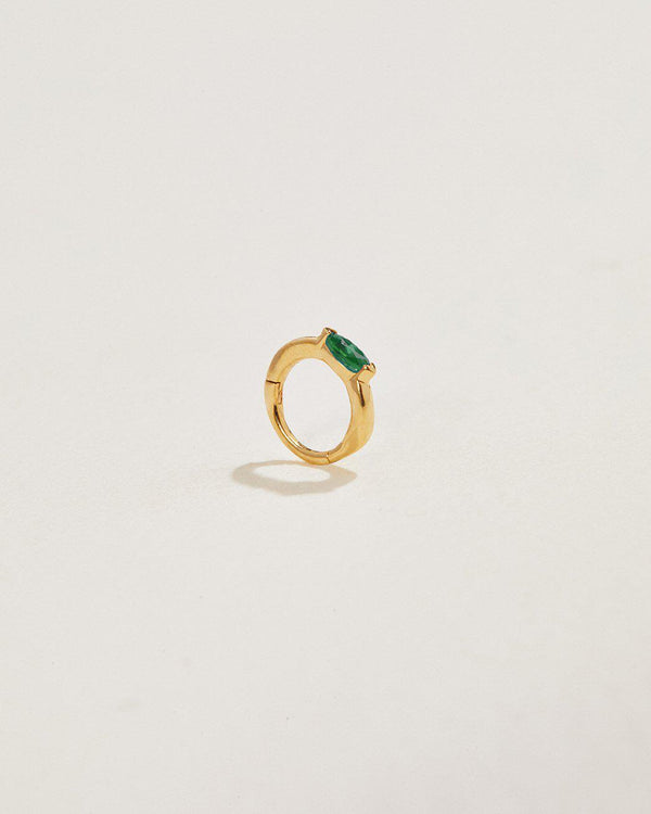 emerald clicker piercing made of 14k gold