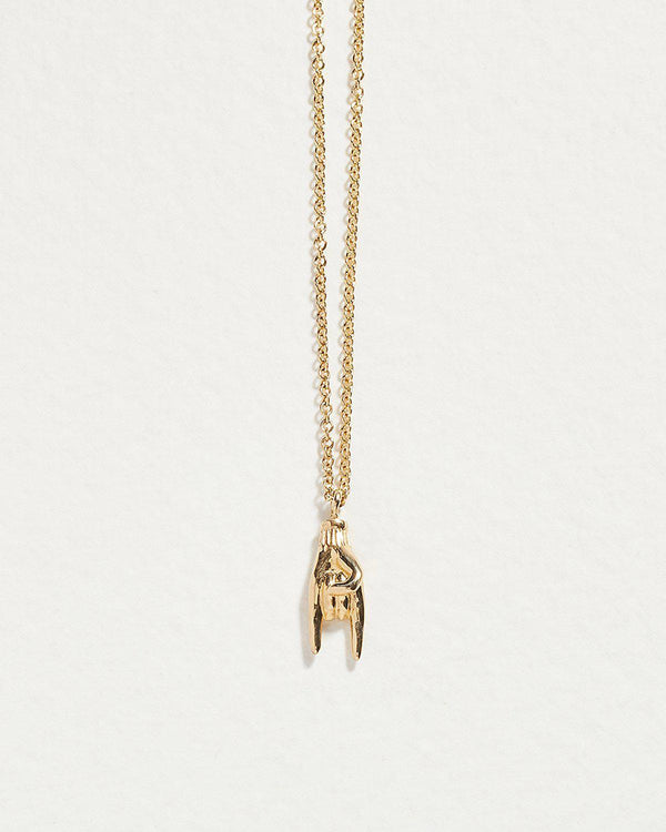mano cornuto necklace with 14k yellow gold