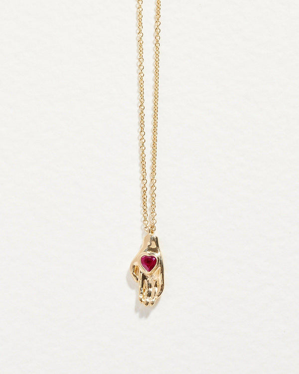 heart in hand pendant with ruby