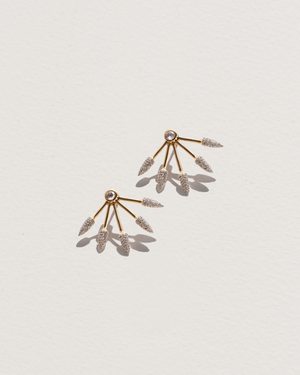 five spike earrings with gold and diamonds