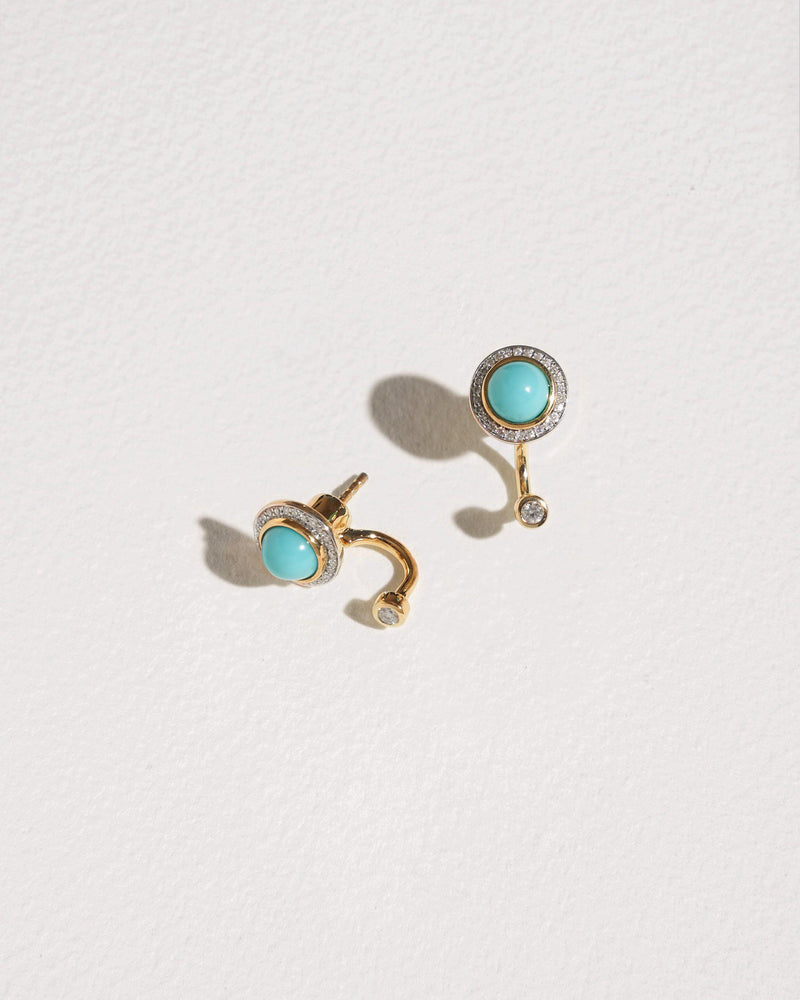 gravitation earrings with turquoise and white diamonds