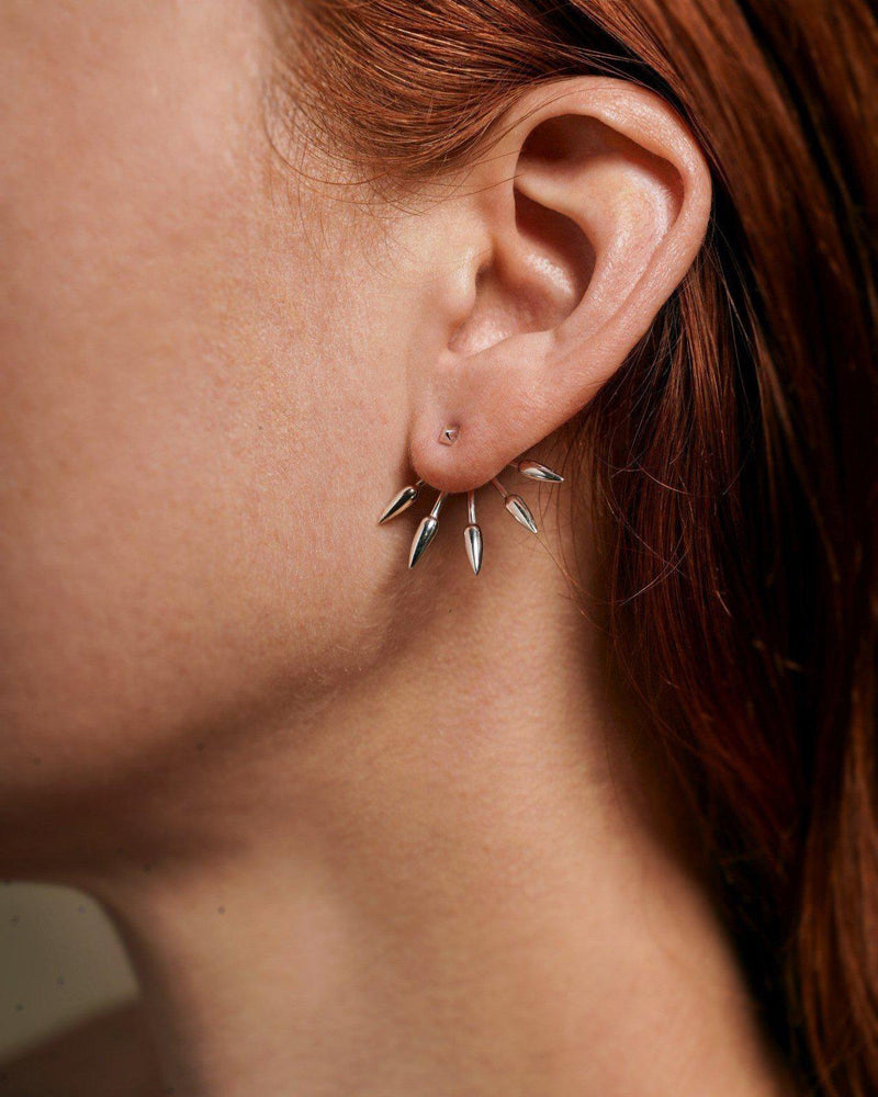 5 spike earrings on the model